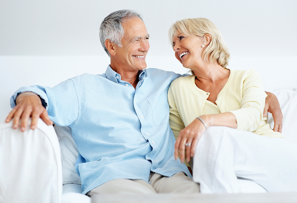 Couple on couch considering In-Retirement Loans